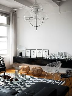 copper wire table stools metal chair chandelier black white rug living room