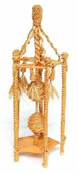 This corn dolly, called a 'Victorian egg timer', was made by Alec Coker as a competition piece for the Lambeth Corn Dolly Gathering in Cambridgeshire. The frame consists of five spirally woven uprights attached to the corners of a pentagonal base made up of parallel corn stalks, with five small lanterns hanging from the roof. The timer inside the structure consists of two spirally woven spheres suspended by plaits.  (MERL/86/144)