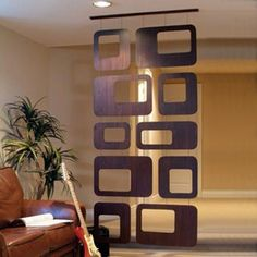 The Sotto veneer square hanging divider creates the allusion of an embellished glass partition.