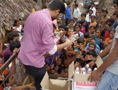 Rev. Luke Yelchuri helps out those who were affected by the flooding in India in 2013.