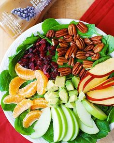 Apple Cranberry Spinach Salad with Pecans, Avocados (and Balsamic Vinaigrette Dressing) Ingredients 10 oz fresh baby spinach (about 10 cups of torn leaves) 1 Granny Smith apple, sliced 1 Gala apple, sliced 1 or 2 avocados, sliced 1 cup pecan halves 2 whole fresh mandarin oranges, peeled; or 1 can of mandarin oranges, drained 1/2 cup dried cranberries Marzetti® Simply Dressed® Balsam