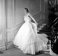 Model wearing an evening gown by Christian Dior in a 1952 photo by Willy Maywald