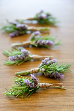 boutonnieres - lavender and rosemary except I would want like a billy button maybe instead of lavender