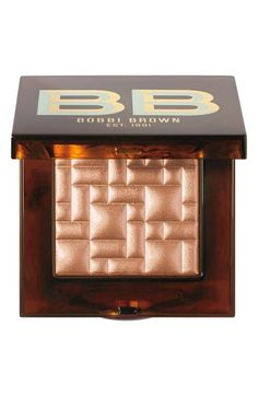"Bobbi Brown's shimmery highlight powder ""Scotch on the Rocks"" Bronze Glow  I couldn't understand why this was so popular, until I finally saw it in person. Not even going to try to describe it. If you see it, don't think - just BUY!!"