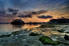 early morning sunrise at Singapore Paris Ris seaside,with the group of 26 sunrise seeker ,use low angle to capture thr foreground  facing the beautiful sky