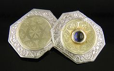 Elegant antique cufflinks with rich blue cabochon Sapphires.  The cufflinks have platinum borders intricately chased with flowing scrolls.  The centers are 14kt yellow gold with beautifully etched motifs.  Crafted in platinum and 14kt gold,  circa 1920.