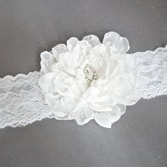 Bridal Garter Ivory White Flower Garter by WeddingAndGems on Etsy, £21.99