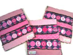 """This Breast Cancer Awareness printed blanket (12""""x13"""") can serve many purposes. If you have a little one who loves to take a lovey with them everywhere, this travels well and tucks easily into a bag.   This is also a wonderfully soothing fidget blanket for individuals with sensory processing ne..."""