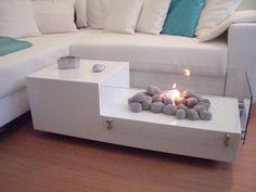Not every home is equipped with a fireplace, but you can still enjoy the luxury of a roaring fire with this unique coffee table. _ Designer: Heim Elich