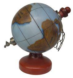 Untitled. Novelty globe form whiskey decanter, Unusual Hand-painted Ceramic World Globe as Decanter  (Published: c1950)