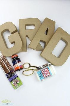 DIY Photo Collage Tutorial and Graduation Party Ideas on Michelle's Party Plan-It. Step by step tutorial for a photo collage centerpiece plus elegant invitations by Tiny Prints!