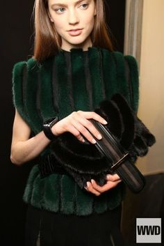 This vest from the Salvatore Ferragamo RTW Fall 2015 collection gets its inspiration from the 1980's. In the 1980's they were developing new and better technologies for the creation of fake fur and dying it more exotic colors like the color seen in this vest. This vest also fits in with the 1980's through the use of large shoulder pads which were popular at the time. 3/5