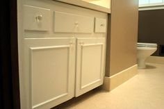 update flat front cabinet doors with simple molding! sooo easy - I ALMOST FEEL LIKE DOING THIS TO THE WHITE DOORS IN MY KITCHEN CAUSE THEY LOOK SO PLAIN...