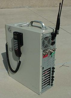 TARMA EMERGENCY COMMUNICATIONS • Portable unit made from an old PC case houses several radios and a cellphone. A gel-cel and charger is built into the bottom of the case. It weighs about 20 lbs.