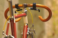 Such an epically classy bike. Those wood handle bars are the most pristine thing I have ever seen on a bike.
