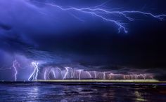 Electric Blue - The most incredible lightning display I have ever seen. Three cells converged and there was lightning 360 degrees around this small beach near Caloundra Australia. This is a stacked image of shots but only 4 minutes and 37 seconds from first to last showing the amazing frequency of this storm. To top it off, the huge Princess cruise liner passed across the bottom of the frame heading out to sea and straight into the storm