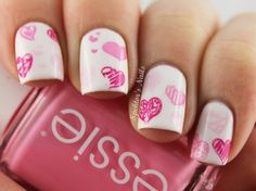 Girly mani featuring pink hearts over white!