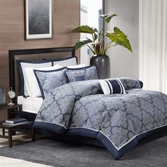 The Madison Park Medina Collection provides a unique update to your bedroom. Its woven jacquard fabrication uses silver thread on a navy blue base creating a beautiful key design on your top of bed. Two solid euro shams and three decorative pillows using embroidery and fabric manipulation to tie this look together.