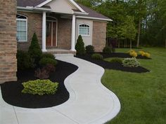 I'm going to pull out all of my old landscaping & redo with black mulch this summer!
