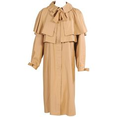 View this item and discover similar for sale at - A ruffled collar and an attached capelet add interest to this cotton coat from the The bow at the neckline is really just the matching belt tied Ted Lapidus, Waterproof Coat, Cape Coat, Vintage Coat, Cool Style, Raincoat, Cold Shoulder Dress, Fashion Outfits, Cotton