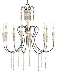 Hannah Chandelier | rust-colored wrought iron arms and Stockholm white finish hand-carved shaft & wooden teardrops.