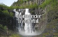 Swim under a waterfall.