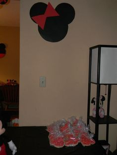Minnie Mouse wall decor- Just cut out 3 circles (one bigger for the head) and 2 triangles for the bow