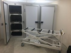 Multiple door mortuary fridge in a funeral directors by Rose house funeral supplies