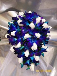 Blue orchids and white tulips bouquet, pretty! But instead of white tulips I want white roses White Tulip Bouquet, White Tulips, White Roses, White Flowers, Blue Orchid Bouquet, Blue Orchid Wedding, Wedding Lavender, Blue Bridal, Peacock Wedding Flowers