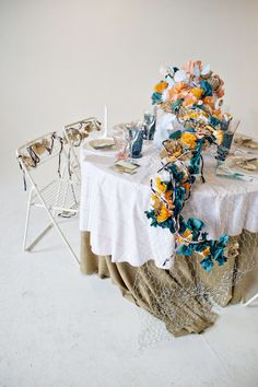 Art installation tablescape made entirely with paper flowers! Click on the image for more.