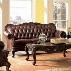 http://www.furnitureanddesignideas.com/victorian-button-tufted-leather-sofa.jpg