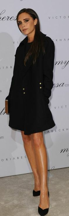 Who made  Victoria Beckham's black coat and clutch handbag that she wore in Munich on November 15, 2013?