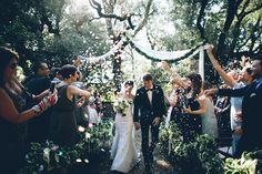 """wDanielle Mastrangelo and Brad Walish's Wedding in Tuscany.  At  the end of our ceremony, our guests showered us with rainbow-colored confetti as we danced down the aisle to The Rolling Stones's """"She's a Rainbow."""" It was so fun!"""