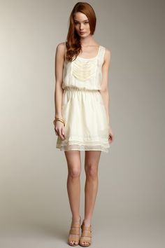 Romantic and subtle. The perfect white sundress for the summer!