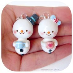 Sweet snowbaby holiday ornaments! The girl is staying with me and the boy has gone to Colorado with my boyfriend :}  #claycharms #polymerclaycharms #claycreations #claycharm #kawaiicharm #kawaiicharms #cutecharm #cutecharms #sculpey #oborochann #oborocharms #kawaiiclay #kawaiioftheday #handmade #polymerclaycreations #polymerclayjewelry #polymercharm #clay #polymer #premo#artisancraft #holidays #christmas #ornament #snowman #snowgirl #hotchocolate #peppermint