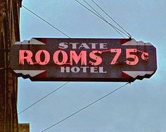 The State Motel-Rooms 75 cents - Seattle, Washington. The sign still exists today, however, one can assume that the rooms have gone up in price since the sign was hung in the 1930s.