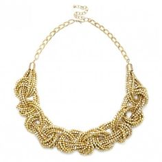 Statement braided necklace with strands of gold beads