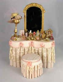 This lovely ladies vanity is draped in pale pink silk fabric, with an antique lace overlay. Rope cording outlines the scalloped apron which is accented with silk roses and ribbon bows. Miniature Dollhouse Furniture, Miniature Rooms, Miniature Houses, Diy Dollhouse, Dollhouse Miniatures, Victorian Dolls, Victorian Dollhouse, Doll House Crafts, Doll Houses