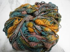 Beehive coils spun from Merino and Bamboo, dyed by Mandie <3