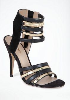 Say hello to heavy-metal Janine. bebe metal & leather sandal