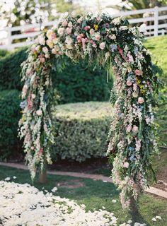 Dripping floral arch  Floral Design: Heirloom Design House - http://www.heirloomdesignhouse.com/