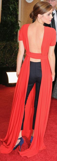 Emma-Watsons-orange-red-Dior-couture-dress-its-a-smock-style-worn-over-skinny-navy-cigarette-pants