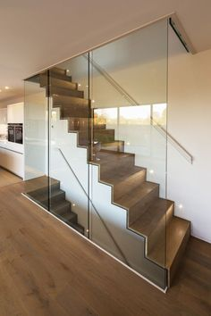 Adrian James Architects have designed the Sandpath House, a 'flat pack' hous. Adrian James Architects have designed the Sandpath House, a 'flat pack' house for a client with a tight budget in Oxford, England. Glass Stairs, Glass Railing, Floating Stairs, Engineered Oak Flooring, Modern Stairs, Interior Stairs, House Stairs, Oak Stairs, Staircase Design