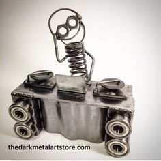 This little Boogie is ready to rock with his turntables and speakers! Sculpture is made from recycled car and motorcycle parts. Stands approximately 6 tall, and is approximately 5 long. Yours will be made to order.