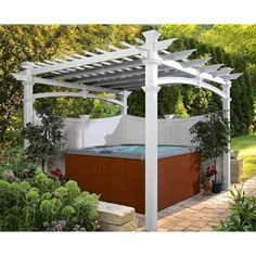 The perfect thing for any hot tub is a Pergola. It can add shade, privacy, and even a place to hang towels or robes!