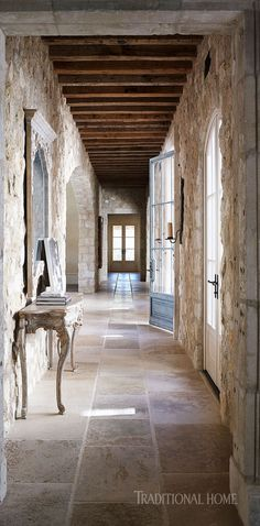 Limestone reclaimed beams and French doors create a dramatic space. - Photo: Richard Powers / Design: Ohara Ohara Davies-Gaetano - August 03 2019 at Double Doors Interior, French Interior, Interior Barn Doors, Exterior Doors, Casas California, California Homes, Traditional Doors, Traditional House, Villas