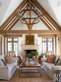 When you need an accent to complement lovely rustic beams, look no further than a simple oversize light fixture. This living room chandelier uses faux candles on two tiers … Home Living Room, Living Room Designs, Living Room Decor, Chandelier In Living Room, Elegant Living Room, Modern Living, Furniture Placement, Family Room Design, My New Room
