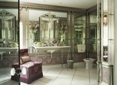 Mirrored panels, crystal columns and marble inlaid with mother-of-pearl create the illusion of depth in one of the villa's bathrooms. Istomin used the slipper chair's early-20th-century pattern as a starting point for the decorative painting on the dado and cornice. Moscow-born and -based decorator Kirill Istomin is today's, no doubt the most important Russian decorator...