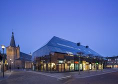 MVRDVs glass building printed with the image of a farmhouse
