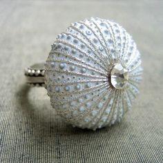 A beautiful white, silver, and diamond sea urchin ring.